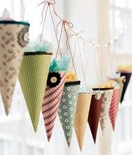 Party Decorating: Paper cones made from patterned scrapbook paper - fill with treats.  Good idea for xmas