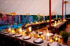 Shared oatmeal runner place mats trimmed with grosgrain ribbon (for a nice crisp pop) lined these rustic farm tables. Rattan chargers were used to add even more texture. The carnival lights introduced a casual, intimate element. Photos courtesy of Charlotte Jenks Lewis
