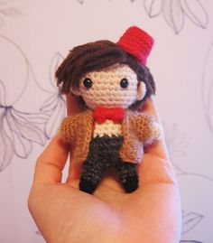 About 8 cm tall Eleven with removable coat and fez (fez is attached with a little hair pin.)