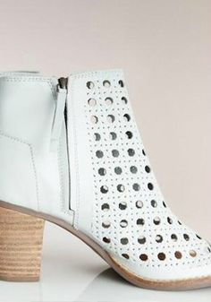 Scale metropolitan heights in this airy and adventurous bootie.