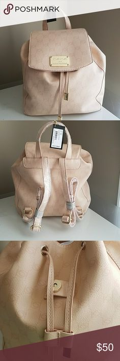 NWT bebe Alexis Backpack Hazelnut colored with gold accents, Alexis backpack from bebe. Has one compartment. One zipper sidewall pouch and two additional open sidewall pouches. The straps are still wrapped, bag is brand new in perfect condition. bebe Bags