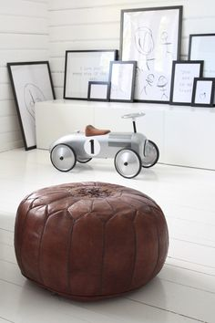 The framed child's drawings and the race car are too cute for a little boy's room.  deasogmia blogspot ♥