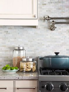 Less dressy than glass but with a high-gloss finish, these ceramic tiles were custom-cut and installed in a running bond pattern. The neutral backsplash creates a mosaic look that is more timeless than trendy.