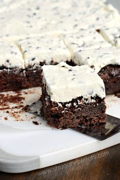 Fudgy Chocolate Chip Zucchini Brownies with Chocolate Chip Frosting are incredibly moist, easy and delicious! Perfect for using that garden zucchini!