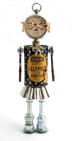 """Fancy Nancy""   Height: 11""   Principal Components: Pocket battery tester, spice tin, tartlet tin, skeleton keys, hose fittings, eyeglass pin"