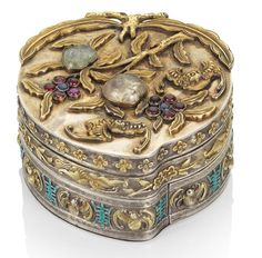 ANTIQUE JEWELED SILVER-GILT AND ENAMEL 'LONGEVITY' PEACH-SHAPED BOX AND COVER Late Qianlong/Jiaqing, two impressed Chinese maker's marks. Rock crystal, rubies, sapphires and paste beads. 7.2cm wide; 7.4cm deep; 4.6cm high.