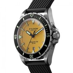 Filson and Shinola knocked it out of the park once again. The Dutch Harbor is a diving watch inspired by classics. It's water resistant up to Casio Watch, Omega Watch, Dutch, Watches, Stuff To Buy, Accessories, Yellow, Watch, Black People