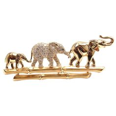 "CARTIER ""Elephant Family"" Diamond Brooch in Yellow Gold"