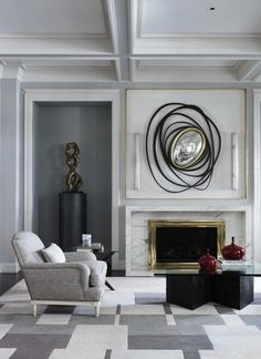 Deniot employed a mix of modern furniture (an angular cocktail table) and traditional elements (decorative moldings) in the design | archdigest.com