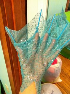 "this is kind of an interesting way to do this... she's used blue zip ties for the ""boning"" and then just sheer sequinned fabric. I wonder if instead of a full glove if the bones could be on rings, to allow the hand under the fin to still function?"