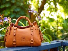 BAG IT! The Small Florentine Satchel is a Dooney classic. Enter the July Win-A-Dooney and this fan favorite could be yours. https://www.facebook.com/dooneyandbourke?v=app_150794994973742&rest=1
