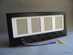 Black Sport Medal display with photo frame. White mat.