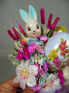 A little girl with a spun cotton head and a vintage Easter bonnet holds her tiny Easter basket that holds a special egg. Description from etsy.com. I searched for this on bing.com/images