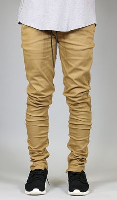 """Fit : Skinny Fit If you are looking for a looser fit, we suggest one size up - Stretch twill for increased wearability - All size inseam 33"""" - Tapered leg silhouette - Elasticized waistband - Drawstri"""