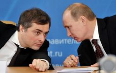 In this Feb. 13, 2012, file photo, Vladimir Putin, then Russia's Prime Minister, confers with his deputy, Vladislav Surkov, during a meeting on the modernization of the secondary education in the Urals city of Kurgan.