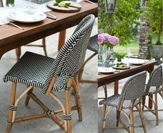 Love the black and white rattan chairs for the patio or inside!