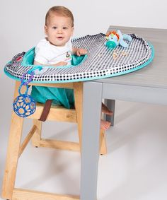 This two-in-one high chair cover and place mat keeps food and toys off of the floor, provides a sanitary barrier and tidy activity space and makes for an easy cleanup during playtime or meal time. It's portable and includes a carrying bag with a built-in wipes pocket, making this cover an essential for dining out.