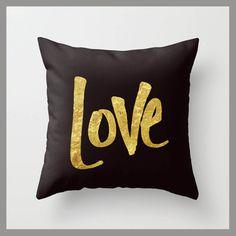 "Square black throw pillow with sparkly gold ""love"" written on the front - soft, comfortable, and pretty!"