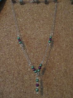Green and purple necklace on silver tone chain. One of my more conventional pieces!
