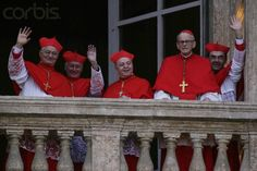 19 Apr 2005, Vatican City, Rome, Italy --- Cardinals clad in their crimson robes salute catholic faithfuls from the balcony of St. Peter's Basilica shortly after the election of Cardinal Joseph Ratzinger of Germany as Pope Benedict XVI by the College of Cardinals. Ratzinger, is the first German pope in centuries. --- Image by © Gianni Giansanti/Immaginazione/Corbis