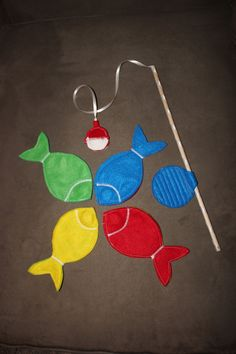 Magnetic Felt Fishing Game- Set of Four Fish and Fishing Pole. $12.00, via Etsy.