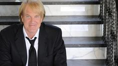 If you suggested a new Twitter hashtag for John Tesh last week, there might be a gift card headed your way.