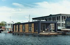 Lisbeth Juul and Laust Nørgaard drew upon their years of experience living on the water to design and build an 860-square-foot floating home in Copenhagen Harbour. The home's minimal form and furnishings reflect the residents' desire to downsize following three years on land.