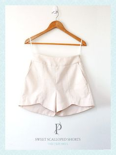 scalloped hem shorts sewing pattern. got 1.5 yds red stretch sateen, 1.5 yards bubble gum pink lining.