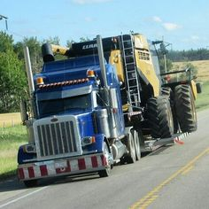 Peterbilt custom 379 with a Claas combine on wagon