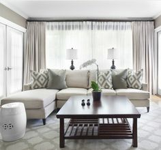 Like a colour? Try layering different shades of it in a space, like this living room does with greys. #livingroom #grey
