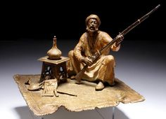 Austrian Cold Painted Bronze by Franz Bergman (Austrian, late 19th/early 20th century)An Arab with a rifle sat on a carpetAn Arab with a rifle sat on a carpet