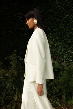 A chic bridal trouser suit for the modern woman. For full on Bianca Jagger vibes this loose fitting tuxedo jacket with its luxe silk satin lapel is a smart choice for your civil ceremony. Inspired by a classic men's tuxedo, it is cut from lightweight crepe, lined with the softest silk and tailored to perfection. Pair with our luxury silk camisole and coordinating wide-leg trousers. Tuxedo Wedding, Wedding Tuxedos, Winter Bridesmaids, Bridal Jumpsuit, Groom Poses, Civil Ceremony, Long Sleeve Wedding, Long Bridesmaid Dresses, Bianca Jagger