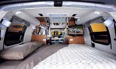 Roadtrek 170-Popular class B motorhome interior - bed arrangement