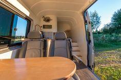 Interior of cool camper van conversion at www.thismovinghouse.co.uk Table and seating area
