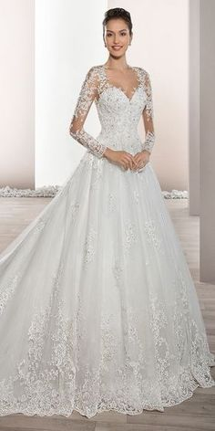 b57d32072900 Delicately beaded appliques embellish this romantic Tulle Ball gown with  Sweetheart neckline and elegant sheer sleeves
