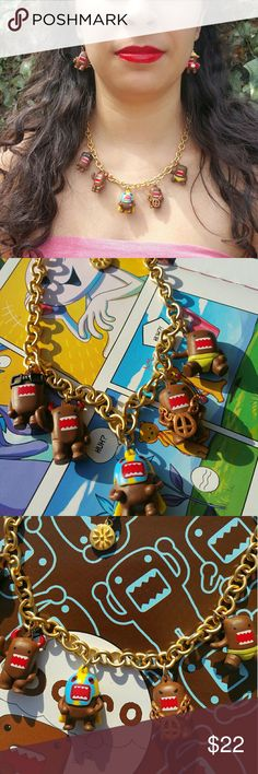 Domo Necklace & Earring Set Who doesn't love the adorable egg hatched Monster from Japan? All his alter egos are featured on this high quality repurposed chain.  *RapperDomo *Devil Domo  *Godzilla Domo *Pool Side Domo *Sumo Domo *Lucha Libre Domo  *Nerd Domo Unique, Funky and surprisingly chic. Comes in a gift box w/free Domo comic. Jewelry