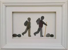 A pair of walkers with back packs created from stone and set inside a 26cm x 35cm (10 x 14) glazed box frame. Frame available in either black or white Words of your choice can be added to the mount at no extra cost.