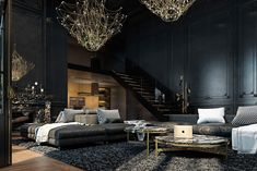 Located in the historical centre of Paris, this two-storied apartment was briefed with Classical architecture in mind. Using dark colours unusual in Parisian décor, a moody feel excels amidst elements of opulence. In the living room, Baxter cobweb chandeliers hang above Gothic wall panelling covered with black gloss. Marble Portoro rounds sit on luxurious grey-and-black shagpiles, while a luscious green panel greets new visitors.