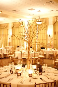 Our centerpieces. Our colors were champagne and ivory <3