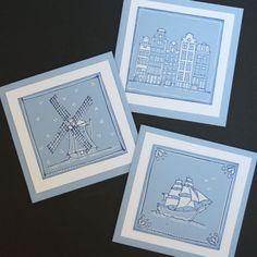In dit blogbericht zie je 3 blauwe kaarten met gestempelde Hollandse tegels erop.