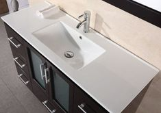 Combining the countertop with the sink gives your vanity a clean and integrated look. It's both practical and functional, as it's easier to install and to clean than other sink types, and aesthetically elegant. Porcelain countertop with integrated drop-in sink by Design Element.
