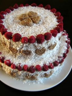 My first raw vegan wedding cake! Red velvet! Cake is made of beets, figs, tangerine, apple, vanilla and cinnamon. The cake is topped with raw white chocolate, than frosted with a cream of coconut, cashew nuts, maple syrup, extra vergine coconut oil and cinnamon. Decorated with dried raspberries, coconut and heartshaped raw white chocolates.