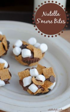 Bring the taste of summer camping home this spring! These Nutella S'more Bites are a tasty play on the traditional campfire s'more. Inexpensive and easy to make these little bites couldn't be tastier. The s'mores are also a perfect treat to surprise your kids with in their lunch for school. - Nutella S'more Bites #NutellaSmore #Smore #Nutella
