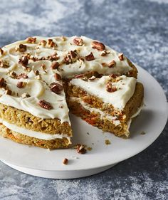 Slow-Cooker Carrot Cake With Cream Cheese Frosting | Everything you love about carrot cake (namely, the cream cheese frosting) slow cooked to a super moist and delectable consistency. If you're nervous about splitting a cake into two layers, here's a trick: stick toothpicks halfway up the sides of the cake at several intervals around its edge. Place a serrated knife right around the toothpicks and use them as your guide. It's easier if your knife is longer than your cake, that way you can…