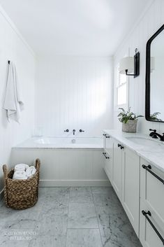 Transitional bathroom - black and white with Carrara marble | Cottonwood Interiors. Photo by Maree Homer.