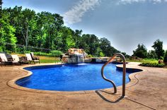 In ground pool featuring a beautiful waterfall. Camp Hill, Beautiful Waterfalls, In Ground Pools, Carlisle, Spas, Swimming, Outdoor Decor, Swim, Swat