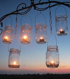 mason jars with tea light candles in them...absolute love this idea and most certainly want to incorporate that in our wedding reception!