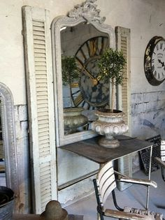 gray-weathered-french-belgian-antiques-urns-table-decorating-ideas-mirrors-shutters