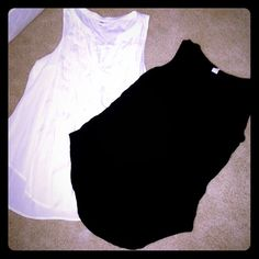 2 Old Navy Sleeveless Button Down Tops 2 Old Navy Sleeveless Button Down Tops. Each worn a few times but in excellent condition! Made of 100% rayon so they're lightweight! Versatile! True to size! Open to offers! Old Navy Tops Tank Tops
