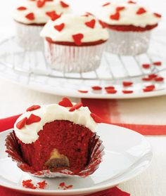 little cakes in cups that are red velvet